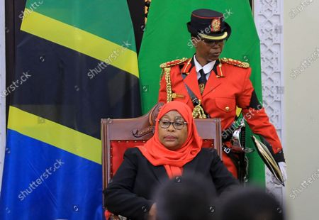 Tanzania's new president Samia Suluhu Hassan, center, is sworn in at a ceremony at State House in Dar es Salaam, Tanzania . Samia Suluhu Hassan made history Friday when she was sworn in as Tanzania's first female president, following the death of her predecessor John Magufuli