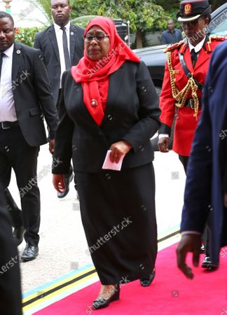 New Tanzanian President Samia Suluhu Hassan (C) arrives to sign a book of condolences for former president John Magufuli after being sworn in as the sixth President of Tanzania in Dar es Salaam, Tanzania, 19 March 2021. Tanzania's former Vice president Samia Suluhu Hassan was sworn in as President and will serve the remainder of Magufuli's 2nd five-year term, which expires in 2025. She is Tanzania's first female Head of State following former president John Magufuli's  death on 17 March 2021 at the age of 61.