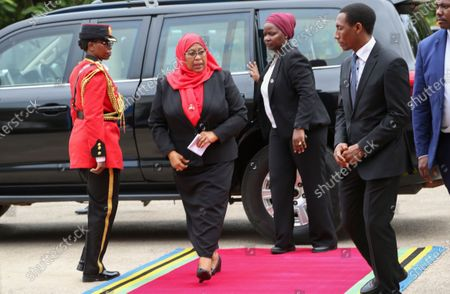 New Tanzanian President Samia Suluhu Hassan (2-L) arrives to sign a book of condolences for former president John Magufuli after being sworn in as the sixth President of Tanzania in Dar es Salaam, Tanzania 19 March 2021. Tanzania's former Vice president Samia Suluhu Hassan was sworn in as President and will serve the remainder of Magufuli's 2nd five-year term, which expires in 2025. She is Tanzania's first female Head of State following former president John Magufuli's  death on 17 March 2021 at the age of 61.