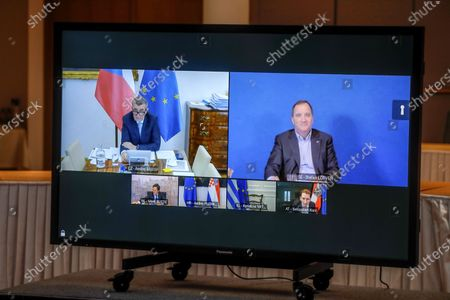 Czech Republic's Prime Minister Andrej Babis, left on screen, and Sweden's Prime Minister Stefan Lofven, right on screen, participate in a video conference meeting with European Council President Charles Michel at the European Council building in Brussels
