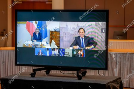 Czech Republic's Prime Minister Andrej Babis, left on screen, and Dutch Prime Minister Mark Rutte, right on screen, participate in a video conference meeting with European Council President Charles Michel at the European Council building in Brussels