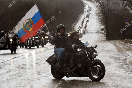 Stock Photo of Festive events dedicated to the seventh anniversary of the reunification of Crimea with Russia, on Mount Gasfort. Head of the Donetsk People's Republic Denis Pushilin (left) and President of the Russian Bikers Association Alexander Zaldostanov (right) during a motorcycle race from Sevastopol to Mount Gasfort as part of events.March 18, 2021. Russia, Crimea