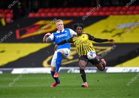 Carlos Sanchez competes for the ball with Kristian Pedersen of Birmingham.; Vicarage Road, Watford, Hertfordshire, England; English Football League Championship Football, Watford versus Birmingham City.