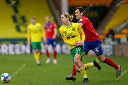 Todd Cantwell of Norwich City is under pressure from Stewart Downing of Blackburn Rovers; Carrow Road, Norwich, Norfolk, England, English Football League Championship Football, Norwich versus Blackburn Rovers.