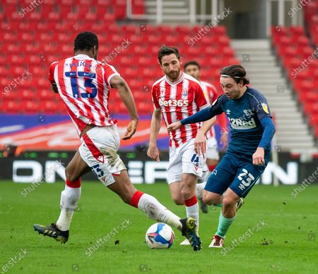 Patrick Roberts of Derby County under pressure from John Obi Mikel of Stoke City; Bet365 Stadium, Stoke, Staffordshire, England; English Football League Championship Football, Stoke City versus Derby County.
