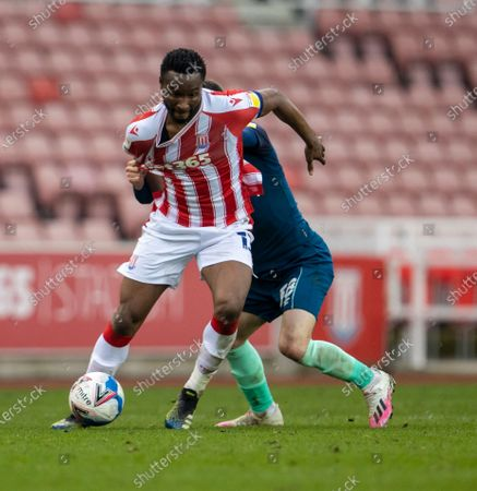 John Obi Mikel of Stoke City is tackled by Jason Knight of Derby County; Bet365 Stadium, Stoke, Staffordshire, England; English Football League Championship Football, Stoke City versus Derby County.