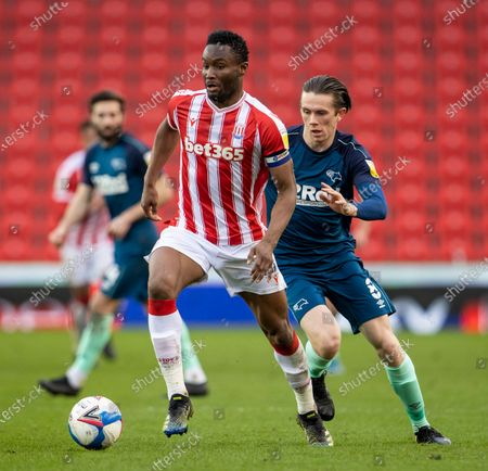 John Obi Mikel of Stoke City under pressure from Max Bird of Derby County; Bet365 Stadium, Stoke, Staffordshire, England; English Football League Championship Football, Stoke City versus Derby County.