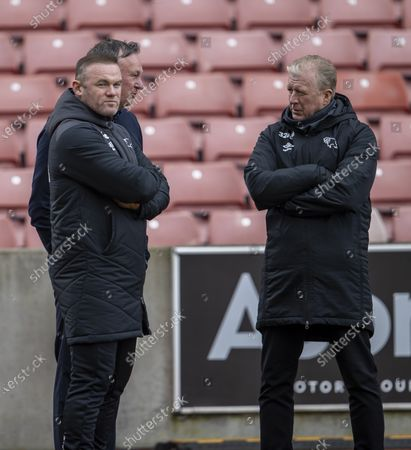Stoke City Manager Michael O'Neill , Derby County Manager Wayne Rooney and Steve McClaren talk during the warm up; Bet365 Stadium, Stoke, Staffordshire, England; English Football League Championship Football, Stoke City versus Derby County.