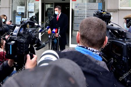 Slovenian President Borut Pahor (C) speaks to the press after receiving the first dose of the Oxford Astra-Zeneca COVID-19 vaccine in front of media at the NIJZ National institute of Public Health in Ljubljana, Slovenia, 19 March 2021. EU member countries reintroduce the AstraZeneca Covid-19 vaccine in their inoculation campaigns following the previous day's European Medicines Agency (EMA) announcement to uphold its approval of the vaccine. Some countries stopped giving the vaccine over fears there might be links between the vaccination against Covid-19 with the AstraZeneca vaccine and a rare number of blood clots.