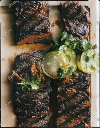 Stock Image of Tri-Tip Beef Roast with Sun-Dried Tomato and Roasted Pepper Relish.