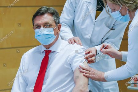 Slovenia's President Borut Pahor is administered AstraZeneca Covid-19 vaccination in Ljubljana, Slovenia, . Slovenia has reversed its suspension of the AstraZeneca coronavirus vaccines after the European Medicines Agency declared the shots are safe. In an apparent bid to dispel public concerns about the vaccine, Slovenia's top officials received the AstraZeneca shots