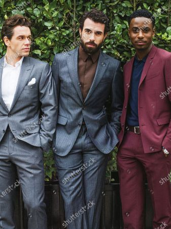 From left: Actors Julian Ovenden wearing a Tom Ford suit, Tom Cullen in Salvatore Ferragamo suit, and Gary Carr in Dior Homme suit. Gary Carr, Tom Cullen, Julian Ovenden