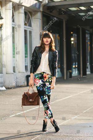 Natalie Suarez, model and style blogger, wearing H&M floral pants with Mango leather jacket and handbag with Matt Bernson booties. Natalie Suarez