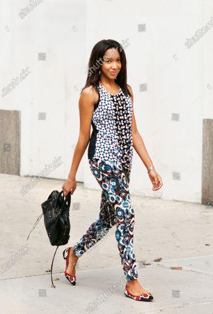Stock Image of Karen Blanchard, blogger, wearing a silk geometric print blouse from Sportmax Code with tribal print pants and flats from Zara and Balenciaga City bag. Karen Blanchard