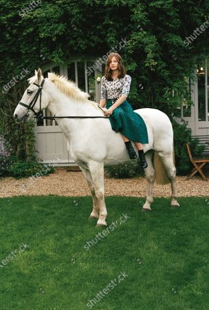 Coco Brooks with Polo, one of her horses, at her family's farm in Oxfordshire. Coco Brooks