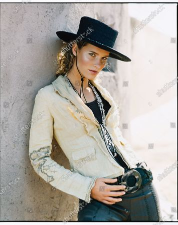 A woman in a hat leans against the wall wearing a blazer with embroidery and unfinished hems. The latest blazers show no signs of office stuffiness with unfinished hems, unstiff shapes and decorative stitching. Accessories with Southwestern flair push the look to the extreme; choose just one for a subtler effect. Jacket, Elie Tahari. Tank, Max&Co. Pants, Theory. Hat, Patricia Underwood for Michael Kors. Necklaces, Roxanne Assoulin for Lee Angel. Belt, Leatherock.