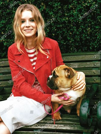 Model Lottie Moss is photographed for Teen Vogue Magazine in 2014 in London, England. Moss wears a red Vanessa Bruno jacket and striped Topshop top. Lottie Moss