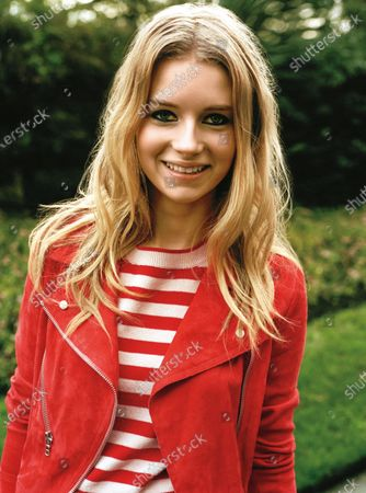 Model Lottie Moss is photographed for Teen Vogue Magazine in 2014 in London, England. Moss wears Vanessa Bruno jacket and striped Topshop top. Lottie Moss
