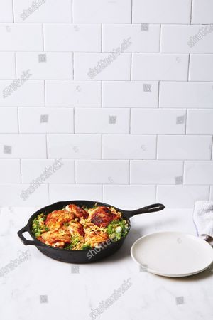 One-Skillet Chicken with Buttery Orzo in cast iron pan.