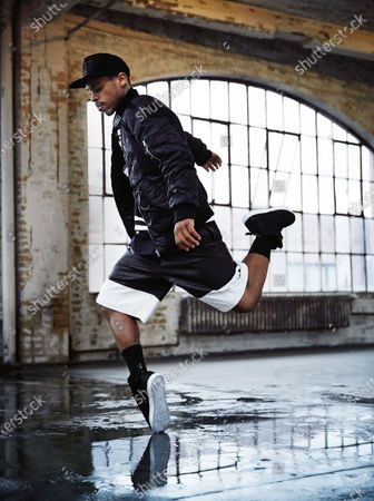 Lil Buck dancing, wearing a BLK DNM jacket, Hood by Air shirt, Alexander Wang shorts and Stampd hat, American Apparel socks and Supra sneakers. Lil Buck