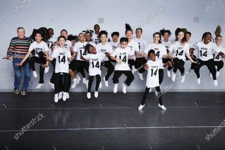 The National Dance Institute dancers wear LPD New York T-shirts customized for Teen Vogue, American Apparel leggings, Hue socks, Keds sneakers, Bucketfeet slip-ons, and assortment of Converse sneakers. Jacques d'Amboise