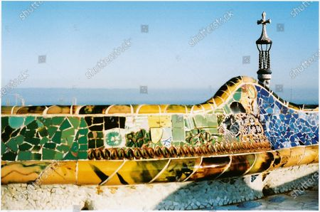 """A view of a railing of Gaudí's Parc Güell. """"I remember going behind the tilted columns of a Gaudí building to kiss my first boyfriend! Every time I visit his work, I get inspired.""""."""