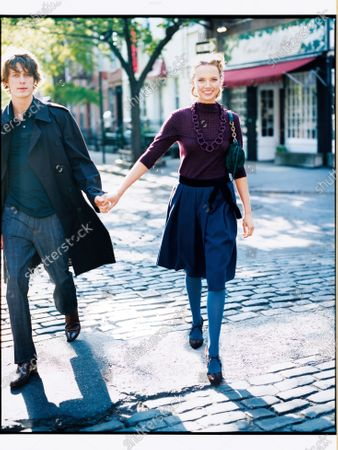 Woman in a purple mock turtleneck sweater, purple necklace, dark blue skirt and blue tights holds hands with a man in a trench coat as she walks down a cobblestone street. Bell skirts are sweet and playful. Have fun with color, too, combining this season's berry-bright blues and purples. Skirt, CH Carolina Herrera. Sweater, A. Cheng. Necklace, Roxanne Assoulin for Lee Angel. Bag, BCBG Max Azria. Tights, Silk Reflections Hosiery. Shoes, Emporio Armani.