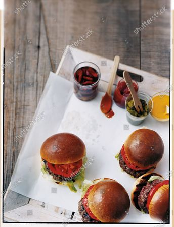 BLT Burgers: bacon, lettuce and tomato topped hamburgers with mustard, ketchup and pickle relish.