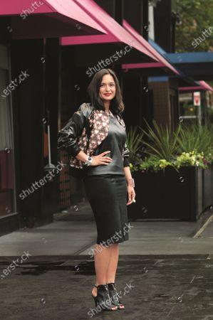 Roopal Patel, fashion executive, wearing sleeveless leather top from Banana Republic with print Prabal Gurung jacket, Janis Savitt collar, Eddie Borgo cuffs, Lanvin pencil skirt, Givenchy shoes. Roopal Patel