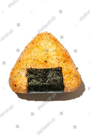 Japanese onigiri sprinkled with seasoning.
