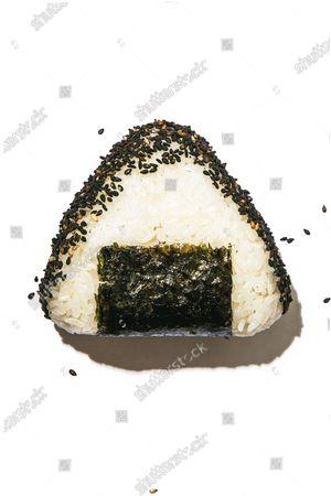 Japanese onigiri with toasted sesame seeds.