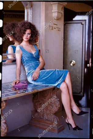 Woman wearing a blue velvet dress. Velvet-and not in black! Stop right there. Back away from your perfectly nice, perfectly inconspicuous standby. Try, just try, a killer color sheath like this. Now look in the mirror: Where have you been hiding? Dress, bra, brooch, Luisa Beccaria; earrings, Roxanne Assoulin for Lee Angel; clutch, Mimi Moulton; slingbacks, Casadei.