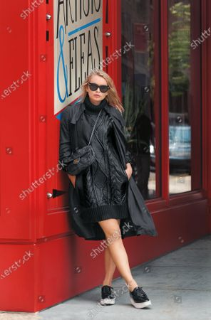 Alexandra Spencer, model and blogger, wearing Tommy Hilfiger leather coated turtleneck dress with Celine sunglasses, Chanel handbag, Scanlan & Theodore silk trench coat and Prada creepers.