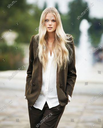 English model and actress Gabriella Wilde wearing a brown Hermes suit. Gabriella Wilde