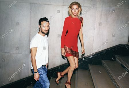 Designer Anthony Vaccarello with model Anja Rubik, who wears a red dress of his design. Anthony Vaccarello, Anja Rubik