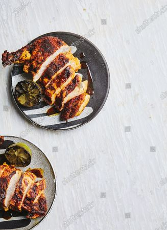 Saucy roast chicken breasts with golden, crispy skin and roasted limes.