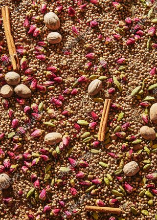 Advieh, a mediterranean blend of spices consisting of cinnamon, cardamom, rose buds, clove, and and nutmeg.
