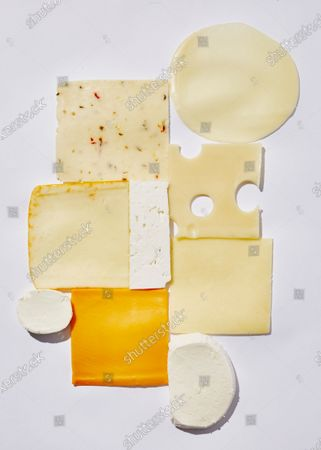Nine types of cheese slices for sandwiches, clockwise from top left: Pepper Jack, Provolone, Swiss, Cheddar, Mozzarella, American, Goat Cheese, Muenster, and Feta.