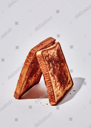 Buttered slices of bread griddled on both sides.