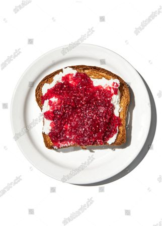 A slice of toast spread with cream cheese and raspberry jam, made with Angostura bitters.