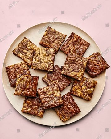Plate of gluten-free chocolate-tahini brownies.