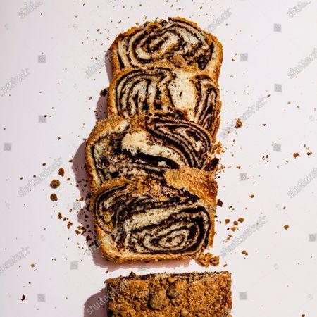 Sliced loaf of chocolate babka.