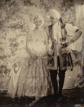 Mrs. Cornelius Vanderbilt Whitney (formerly Marie Norton) wearing a powdered wig and hoop skirt costume; and Mr. R. Penn Smith, Jr., wearing a powdered wig and costume for court of Louis XIV era. Marie Vanderbilt Whitney