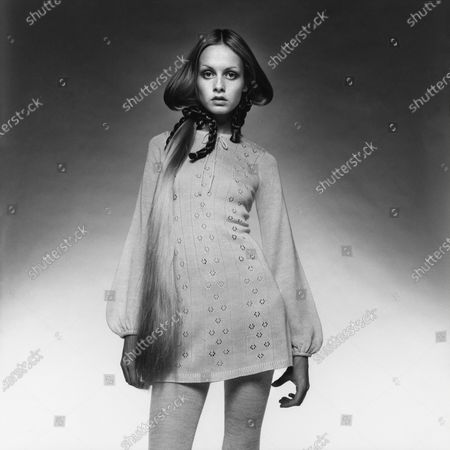 Twiggy wearing a knit dress with eyelets, by Daniel Hechter for Fox Run, socks by Bewitching; Hair extensions by Bob Kelly and braids by Reid-Meredith. Twiggy