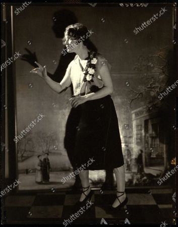 Mrs. Harriman Russell as Fanny Brice, gesturing with her hands, with three roses on her blouse, at Elsa Maxwell's masquerade ball at the Ritz-Carlton in New York City. Mrs. Harriman Russell