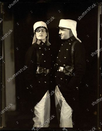 Countess Zoppola and Loel Guiness wearing Foreign Legion costumes, as two brothers Geste at Elsa Maxwell's masquerade ball held at the Ritz-Carlton in New York City. Countess Zoppola, Loel Guiness
