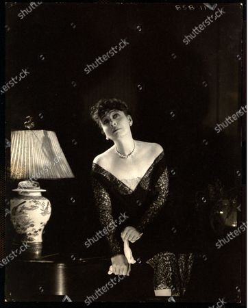 Mrs. Averell Dougherty as Helen Morgan, at Elsa Maxwell's masquerade ball at the Ritz-Carlton in New York City. Mrs. Averell Dougherty