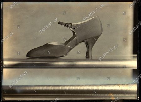 Crepe de chine one-strap slipper with a metal buckle on side, from Bunting.