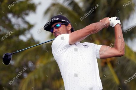 Rafa Cabrera Bello of Spain hits from the 12th tee during the second round of the Honda Classic golf tournament, in Palm Beach Gardens, Fla