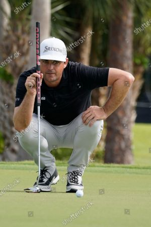 Keegan Bradley lines up his putt on the third green during the second round of the Honda Classic golf tournament, in Palm Beach Gardens, Fla